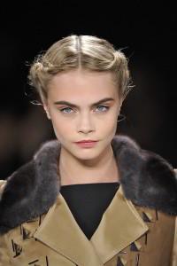 Short, blond updo with dutch braids
