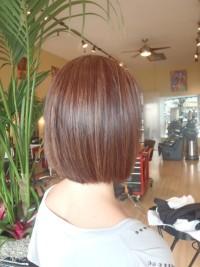 Medium-length, brown hairstyle