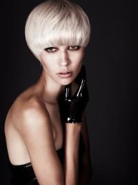 Short, bowl cut hairstyle