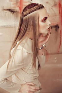 Long, straight, blone hairstyle with braided headband