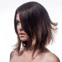 Medium-length, brown hairstyle with choppy endings