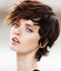 Short, choppy, wavy, brown hairstyle