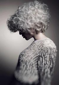Medium-length hairstyle with platinum spring curls