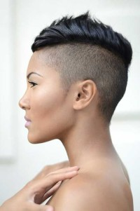 Short, pixie, black haircut with shaved sides and back and mohawk