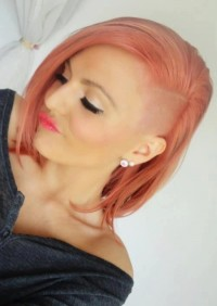 Medium-length, strawberry blonde hairstyle with shaved side