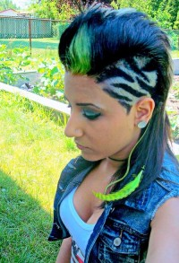 Medium-length, colourful haircut with shaved pattern and blue hair