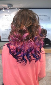 Long, curly, brown hairstyle with pink and violet endings