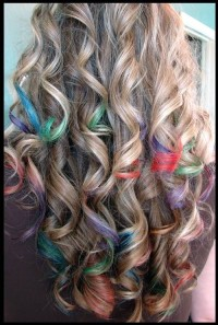 Long, curly, blonde hairstyle with colourful streaks