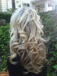 Long, messy looking, blonde hairstyle