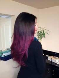 Long dark hair with red highlights
