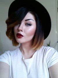 Medium- length hairstyle with a hat