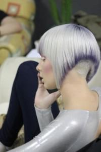 Short, bowl-cut hairstyle for platinum hair