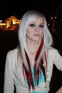 Long, blonde hairstyle with red highlights