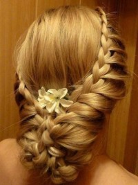 Lovely updo for weeding with braids and flower ornaments
