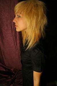 Medium-length, choppy, blond hairstyle