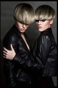Short, bowl cut hairstyle with blonde highlights