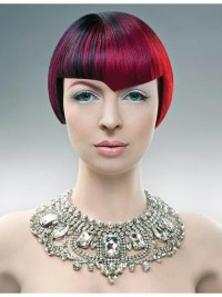 Short, red haircut with asymmetrical fringe