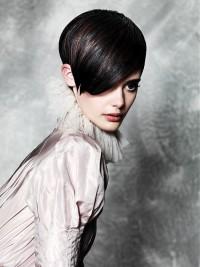Short, black haircut with longer bangs