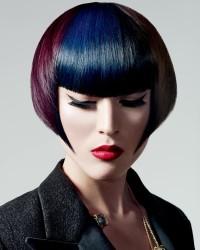Short, bowl cut hairstyle for dark red women with dark blue fringe