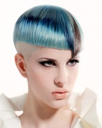 Short, bowl cut hairstyle with shaved side and blue top