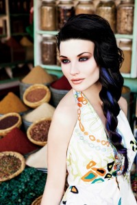 Long, black hairstyle with braid and violet streaks