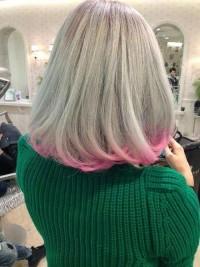 Medium-length, blonde hair with pink endings