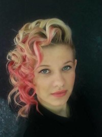 Short blonde hair with curls and pink highlights
