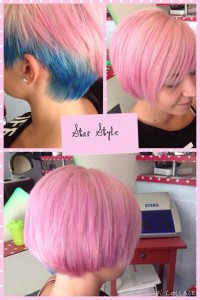 Short, bob, pink haircut with blue coloured sides.