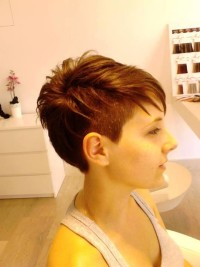 Short, choppy, pixie, red hairstyle
