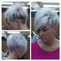 Short, messy, choppy, platinum blonde haircut