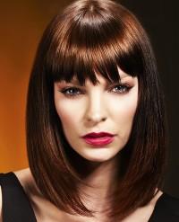 Medium-length, brown hairstyle with bangs
