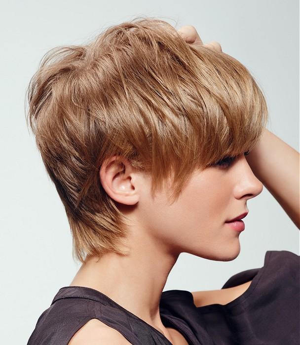 Short, choppy, blonde hair with bangs,
