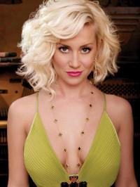 Medium length, blonde, wavy, curly hairstyle