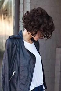 Medium length, curly, dark brown hairstyle