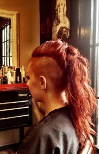 Long, red hairstyle with shaved sides