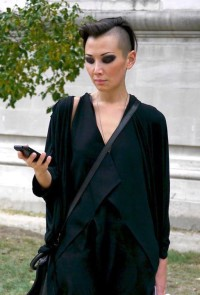 Short, dark haircut with shaved sides and mohawk