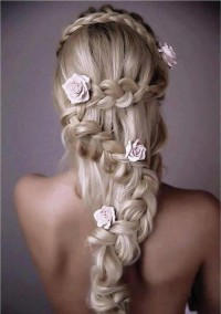 Long, blonde hairstyle for wedding with braids and flowers