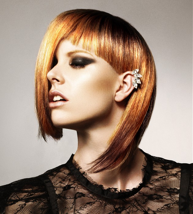 Short, assymetrical, blonde hairstyle with razored fringe