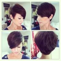 Short, dark brown, pixie hairdo