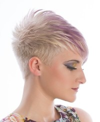 Short, pixie haircut for blonde girls with pink-coloured fringe